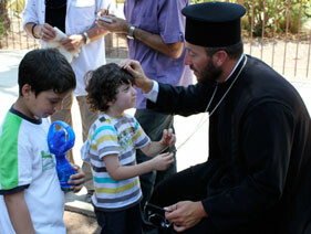 FM-with-child-at-Capharnaum_small